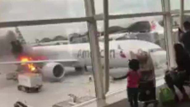 Fire breaks out next to American Airlines plane at Hong Kong airport