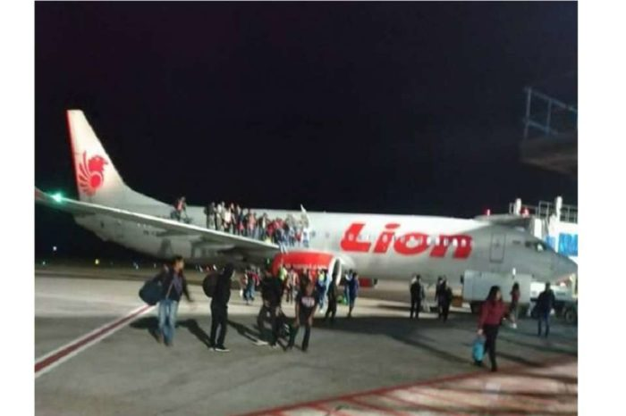 Passenger opens emergency exit on plane after bomb threat
